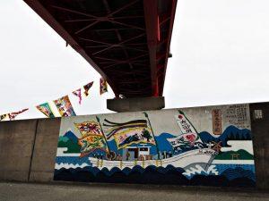 堤防壁画「御幣鯛奉納祭ノ図」(伊勢市神社港)